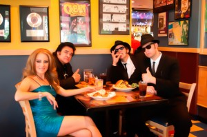"Some of the cast from the ""Legends in Concert Show"" ""Celine Dion,"" Brigitte Valdez; ""Johnny Cash, Paul Eve and ""The Blues Brothers"" Bucky Heard as ""Jake Blues"" and Justin Clark as ""Elwood Blues"" enjoying their meal at the Dick Clark's American Bandstand Grill."