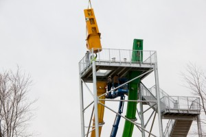 "Launch capsule being lifted into place on top of White Water's ""KaPau Plummet."""