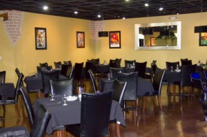 A portion of La Piazza's warm intimate dining room.