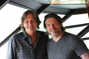 "Billy Dean, right, and Paul Harris on the bridge of the ""Landing Princess"" during the cruise."