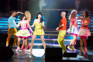 Katy Perry performing with Dancer in one of the many colorful costumes she wears during her set.