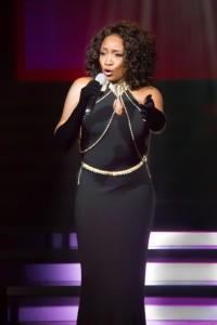 """Cynthia Minx as Whitney Houston singing """"I Will Always Love You."""""""