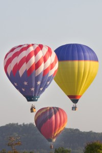 Three of about 20 balloons during their lift off from the Branson Balloon Festival.