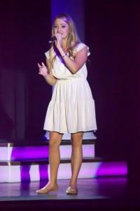 """Kendra Dyer singing her original song, """"Surrender."""""""