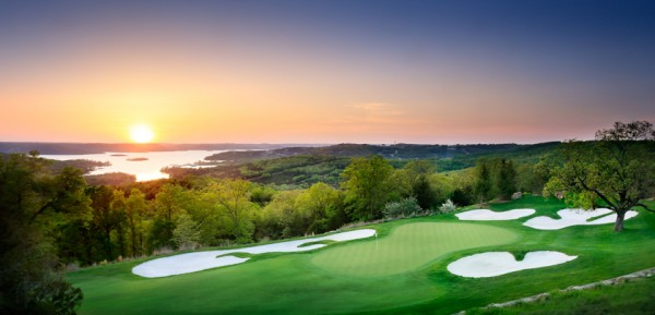 The beautiful Top of the Rock Par 3 Course with the sun setting over Table Rock Lake.