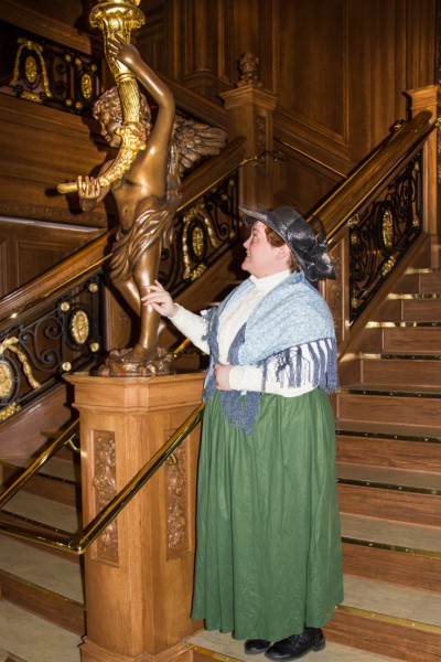 Miss McDermott admiring the statute at the foot the Titanics' Grand Staircase. S