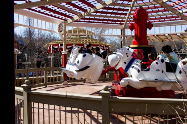 """Lucky's Dizzy Dogs, a bouncy ride on Dalmatians racing around a fire hydrant, is sure to be hit with the younger """"recruits."""""""