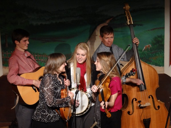 Petersen Family Bluegrass Band on stage, Matthew right, Karen, Ellen, Katie and Jon. *