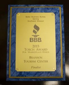 The Southwestern Missouri Better Business Bureau's Torch Finalist plaque presented to Branson Tourism Center for Marketplace Ethics.