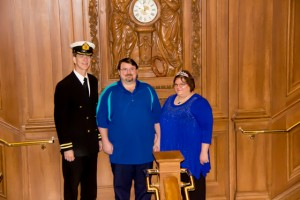 "Edward and Stacy Gilmore, on the Grand Staricase with 1st Officer Steve Patterson who ""officiated"", after renewing their vows in celebration of their 15th wedding anniversary."