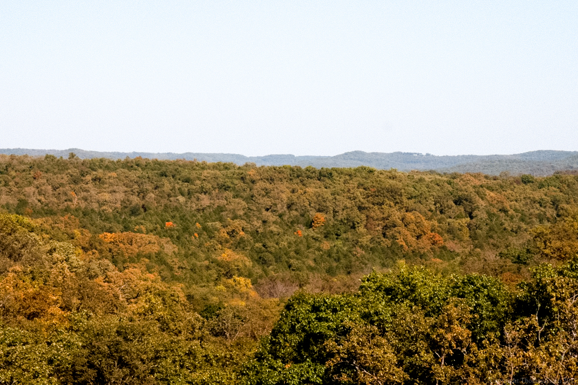 The first blush of the color to come spreads across a scenic Ozark vista.