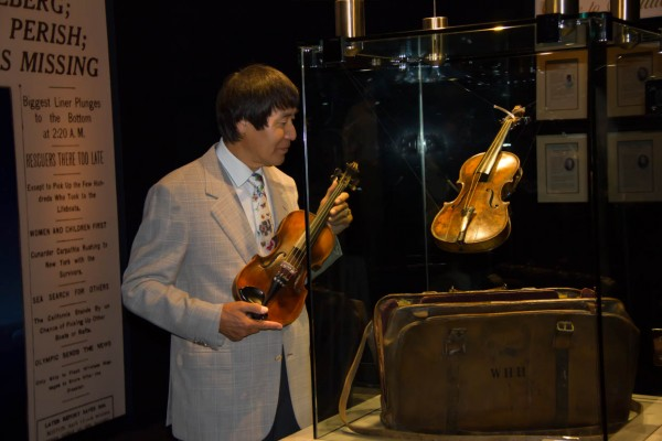 Shoji Tabuchi viewing the  Wallace Hartley Titanic Violin and paying his respects to his fellow musicians who perished that night.