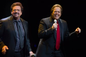 Jay and Jimmy Osmond reminiscing with the audience.