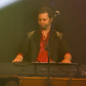 "Although Patrick Haygood is not ""center stage"" a lot he does a great job on the keyboards, vocals, and is playing the keyboard or giving vocal support on just about every number."