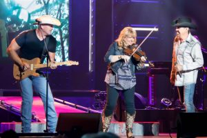 """Raiding the Country Vault's Colt Prather, right, Melody Hart, and Billy Yates during their spectacular performance of ""The Devil Went Down To Georgia."""