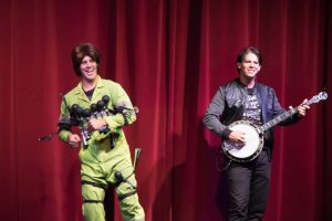 """Cousin Julio """"horning"""" in on Jonathan's banjo act."""