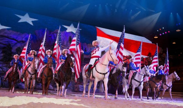 The beautiful horses, color, pageantry of Dixie Stampede's Finale Finale .*
