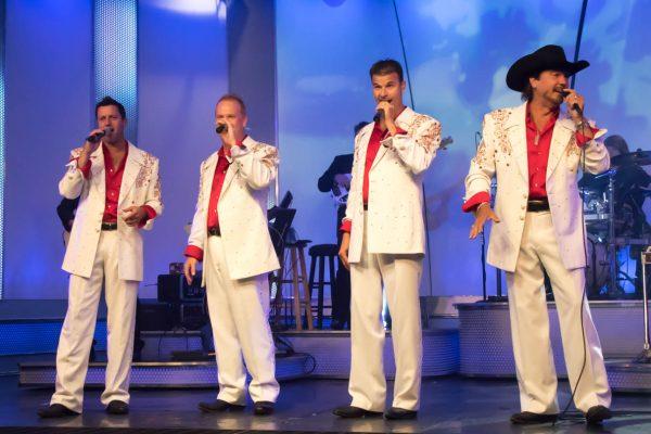 "Pierce Arrow quartet rehearsing ""Hark the Herald Angels Sing,"" for their upcoming Christmas Show; Tony Turner, left, Travis Spratt, Scott Fraker, Dan Birtton"